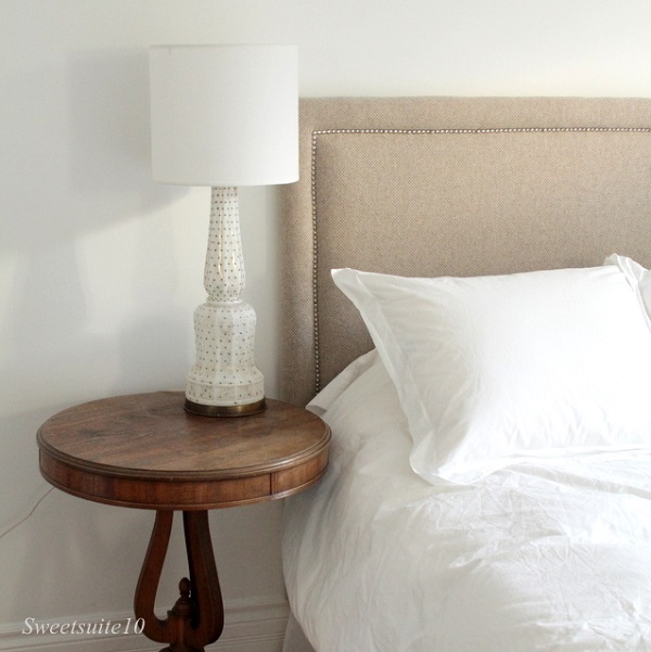 Oatmeal-upholstered-headboard-with-silver-nailheads (1)