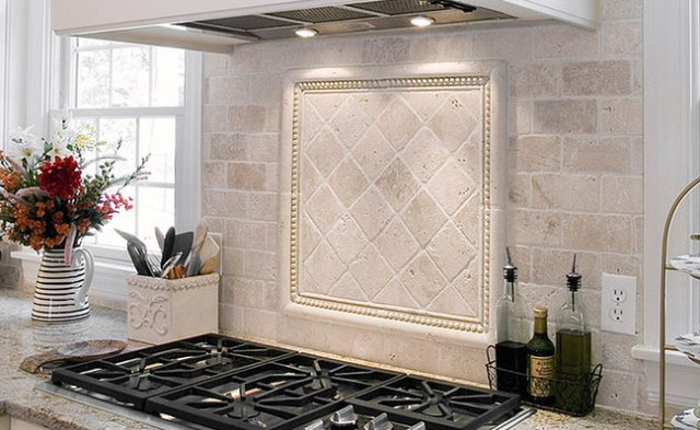 antiqued-ivory-tile-backsplash-white-cabinets